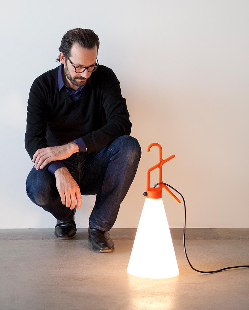 Konstantin Grcic with his May Day Lamp from Flos